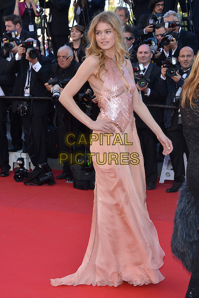Doutzen Kroes.'Le Passe'  film premiere at the 66th Cannes Film Festival, Cannes, France, 17th May 2013..full length peach nude dress side cut out pink shiny strappy gold sandals hand on hip .CAP/PL.©Phil Loftus/Capital Pictures