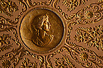 Golden lid cover for thread with engraved leaf patterns and woman's face