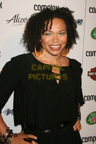 TISHA CAMPBELL .Complex Magazine's 5th Anniversary Party at Area, Los Angeles, California, USA..April 10th, 2007.half length black top gold hoop earrings .CAP/ADM/BP.©Byron Purvis/AdMedia/Capital Pictures