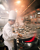 SINGAPORE, Asia, side view of a chef preparing food at Orchard Hotel