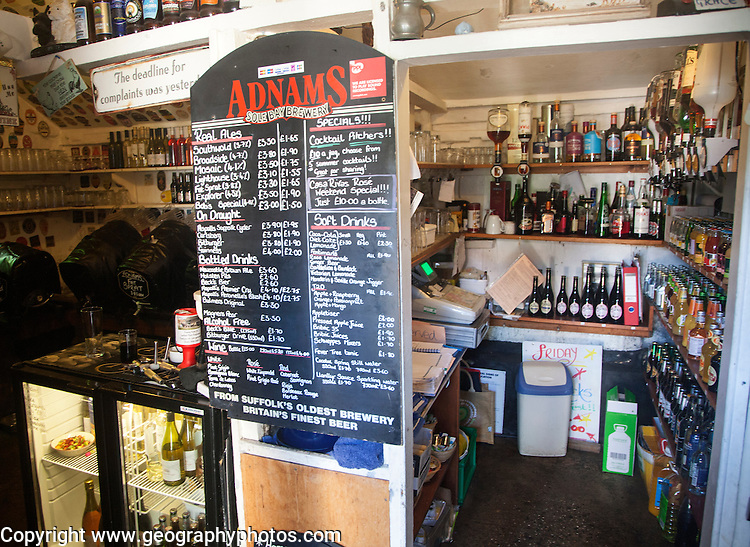 Price list of drinks at bar inside The King's Head pub, Laxfield, Suffolk, England, UK