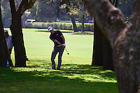 Jordan Spieth (USA) hits his approach shot from the trees on 1 during round 1 of the World Golf Championships, Mexico, Club De Golf Chapultepec, Mexico City, Mexico. 3/2/2017.<br /> Picture: Golffile | Ken Murray<br /> <br /> <br /> All photo usage must carry mandatory copyright credit (&copy; Golffile | Ken Murray)