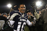 Nevada Wolf Pack quarterback Colin Kaepernick celebrates with fans as he leaves the field after a 34-31overtime win over Boise State during the NCAA college football game Friday night, Nov. 26, 2010, in Reno, Nev. (AP Photo/Cathleen Allison)