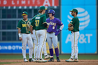 Daniel Cabrera (8) of the LSU Tigers is surrounded by the Baylor Bears infield as they wait for a video replay review during game five of the 2020 Shriners Hospitals for Children College Classic at Minute Maid Park on February 28, 2020 in Houston, Texas. The Bears defeated the Tigers 6-4. (Brian Westerholt/Four Seam Images)