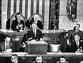 "Washington, DC - (FILE) -- Astronaut Neil Armstrong displays his boyish grim as he shares the rostrum in the United States House of Representatives with fellow lunar travelers Michael Collins, left, and Edwin E. ""Buzz"" Aldrin, Jr., right, as they address a Joint Session of Congress on September 16, 1969.   Armstrong's remarks enjoyed the applause of Vice President Spiro Agnew, left rear, and Speaker of the House John McCormick (Democrat of Massachusetts), rear right..Credit: Arnie Sachs / CNP"