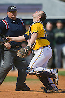 Catcher Lester Rivenbark #14 of the North Carolina A&T Aggies gives chase to a foul pop fly at War Memorial Stadium March 23, 2010, in Greensboro, North Carolina.  Photo by Brian Westerholt / Four Seam Images