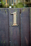 Number One brass numeral on wooden gate
