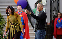 United States President Barack Obama and first lady Michelle Obama attend a Halloween event at the South Lawn of the White House October 31, 2016 in Washington, DC. The first couple hosted local children and children of military families for trick-or-treating at the White House.<br /> Credit: Olivier Douliery / Pool via CNP /MediaPunch