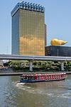 Asakusa Sumida River waterfront view, riverboat and the Asahi Building and flame, Tokyo, Japan