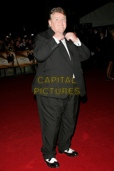 "ROBBIE COLTRANE .The Royal World Premiere of ""Quantum Of Solace"" at the Odeon Leicester Square, London, England..October 29th 2008.James Bond full length black tuxedo white ballroom shoes .CAP/AH.©Adam Houghton/Capital Pictures."
