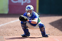 Lexington Legends catcher Chad Johnson (7) warms up in the dugout before a game against the Hagerstown Suns on May 19, 2014 at Whitaker Bank Ballpark in Lexington, Kentucky.  Lexington defeated Hagerstown 10-8.  (Mike Janes/Four Seam Images)