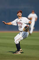 Shortstop Tyler Cannon #10 of the Virginia Cavaliers tracks a fly ball in short left field against the St. John's Red Storm in the championship game of the Charlottesville Regional at Davenport Field on June 7, 2010, in Charlottesville, Virginia.  The Cavaliers defeated the Red Storm 5-3.  Photo by Brian Westerholt / Four Seam Images