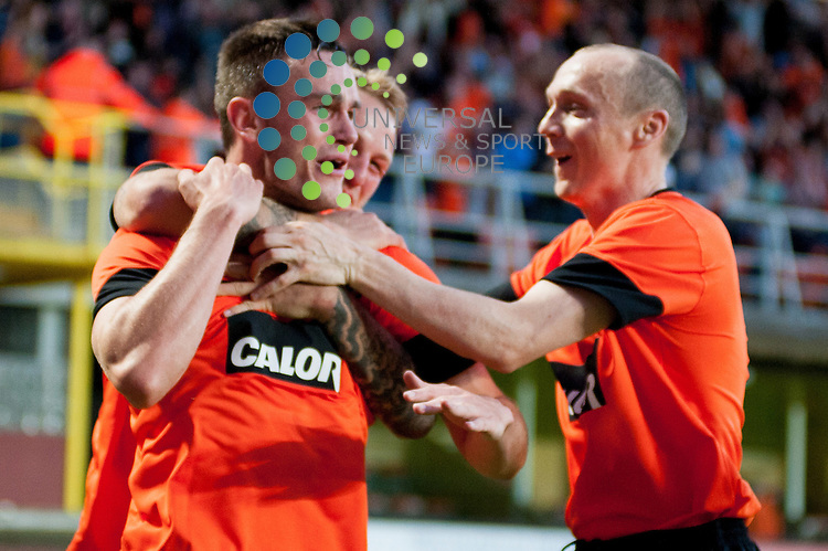 Dundee Utd players Willo Flood and Johnny Russell congratulate Keith Watson...Dundee Utd and Dinamo Moscow contest the first leg of their UEFA Europa League Qualifying Third Round tie at Tannadice in Dundee on Thursday 2nd August.