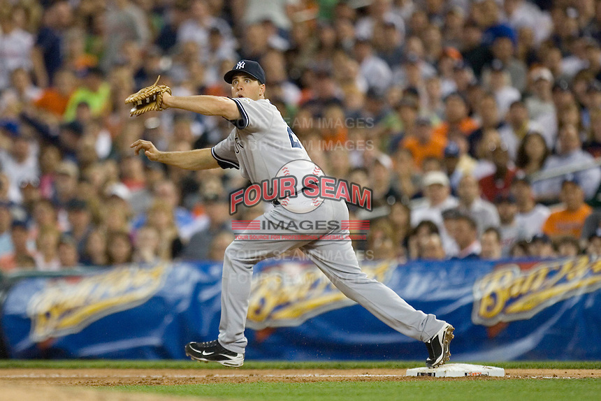 First baseman Mark Teixeira #25 of the New York Yankees stretches for a throw at Comerica Park April 27, 2009 in Detroit, Michigan.  Photo by Brian Westerholt / Four Seam Images