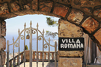 Signboard on the gates to luxury hotel Villa Romana in French riviera
