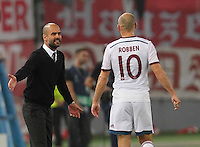 Bayer's headcoach Josep Guardiola and  Bayer's Arjen Robben during the Champions League Group E soccer match between As Roma and FC Bayern Munchen at the Olympic Stadium in Rome october 21 , 2014.