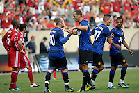 Manchester United forward Wayne Rooney (10) is congratulated by teammate Rio Ferdinand (5) after scoring Manchester United's first goal.  Manchester United defeated the Chicago Fire 3-1 at Soldier Field in Chicago, IL on July 23, 2011.