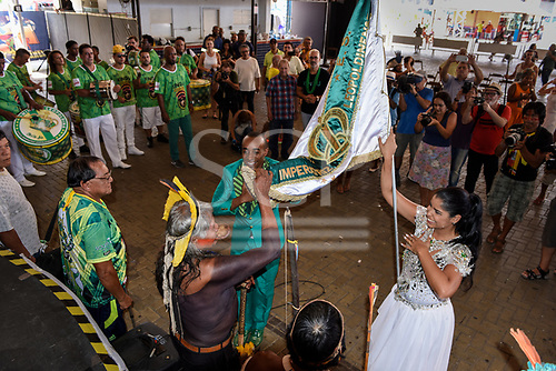 Rio de Janeiro, Brazil. Imperatriz Leopoldinense samba school; preparations for carnival. Chief Raoni Metuktire acknowledges the Imperatriz Leopolinense standard.
