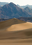 Sand dunes at Mesquite Flats in Death Valley with the mountains in the background