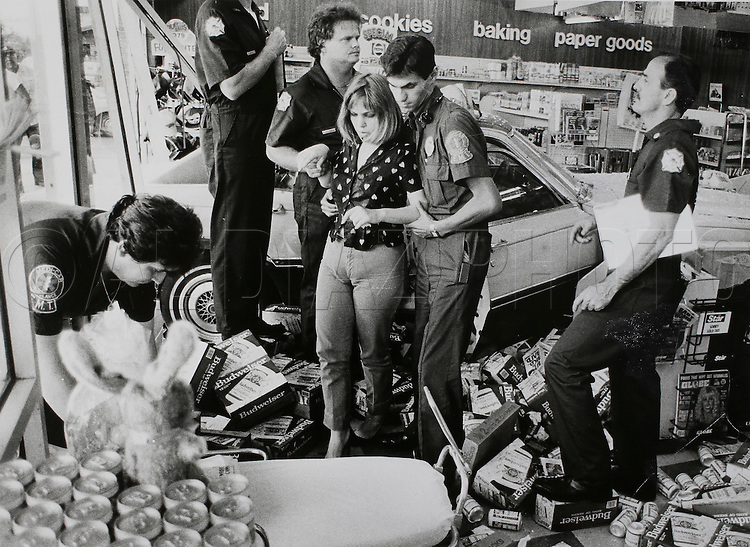 Hialeah Fire Rescue aids a women who crashed into a convenience store in Hialeah in 1985.