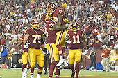 Washington Redskins wide receiver Josh Doctson (18) celebrates his third quarter touchdown with offensive tackle Morgan Moses (76) against the Oakland Raiders at FedEx Field in Landover, Maryland on Sunday, September 24, 2017.  Looking on are Washington Redskins offensive guard Brandon Scherff (75) and wide receiver Terrelle Pryor (11).  The Redskins won the game 27-10.  <br /> Credit: Ron Sachs / CNP