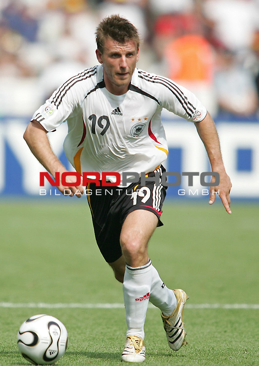 FIFA WM 2006 - Gruppe A ( Group A )<br /> Play #33 (20-Jun) - Ecuador vs Germany.<br /> Bernd Schneider from Germany with the ball during the match of the World Cup in Berlin.<br /> Foto &copy; nordphoto