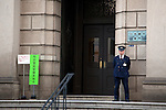 A security guard monitors the entrance of the Bank of Japan (BOJ) on April 30, 2015, Tokyo, Japan. After voting 8-1 the BOJ board members announced to stick to its plan to expand the monetary base at the rate of 673 billion USD per year. After the BOJ communicated their decision the Nikkei stock index dropped 2 percent. (Photo by Rodrigo Reyes Marin/AFLO)