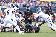 Philadelphia, PA - December 8, 2018:  Army Black Knights running back Darnell Woolfolk (33) gets tackled by several Navy Midshipmen defenders during the 119th game between Army vs Navy at Lincoln Financial Field in Philadelphia, PA. (Photo by Elliott Brown/Media Images International)