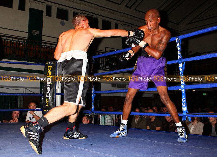 Thomas Grublys (Canning Town, black shorts) defeats Nick Corret (Grimsby, purple shorts) in a Light-Middleweight contest at York Hall, Bethnal Green, promoted by Maloney Promotions - 13/09/08 - MANDATORY CREDIT: Gavin Ellis/TGSPHOTO - Self billing applies where appropriate - 0845 094 6026 - contact@tgsphoto.co.uk - NO UNPAID USE.