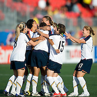 USA team celebrates Shannon Boxx's goal. The US Women's National Team defeated the Canadian Women's National Team, 4-0, at BMO Field in Toronto during an international friendly soccer match on May 25, 2009.