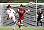 02 September 2012: NC State's Danny DiPrima (14) clears the ball away from Santa Clara's Dylan Autran (22). The North Carolina State University Wolfpack defeated the Santa Clara University Broncos 2-1 at Koskinen Stadium in Durham, North Carolina in a 2012 NCAA Division I Men's Soccer game.