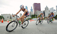 29 JUN 2014 - CHICAGO, USA - Lukas Verzbicas (USA) (left) of the USA takes a corner on the bike during the elite men's ITU 2014 World Triathlon Series round in Grant Park, Chicago in the USA (PHOTO COPYRIGHT © 2014 NIGEL FARROW, ALL RIGHTS RESERVED)
