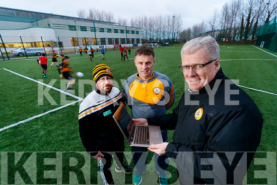 Austin Stacks Chairman Liam Lynch celebrates winning their their second MacNamee award for their Stacks 100 website along with coaches Ronan Kavanagh and William Kirby.