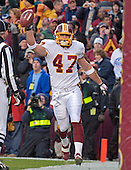 Washington Redskin h-back Chris Cooley (47) celebrates after catching a first quarter touchdown pass against the Dallas Cowboys at FedEx Field in Landover, Maryland on December 18, 2005. The Redskins won the game 35 - 7.<br /> Credit: Arnie Sachs / CNP