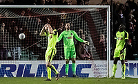 Bolton Wanderers' (l-r): Ethan Hamilton , Remi Matthews and Toto Nsiala despair after conceding an own goal<br /> <br /> Photographer Andrew Kearns/CameraSport<br /> <br /> The EFL Sky Bet League One - Lincoln City v Bolton Wanderers - Tuesday 14th January 2020  - LNER Stadium - Lincoln<br /> <br /> World Copyright © 2020 CameraSport. All rights reserved. 43 Linden Ave. Countesthorpe. Leicester. England. LE8 5PG - Tel: +44 (0) 116 277 4147 - admin@camerasport.com - www.camerasport.com