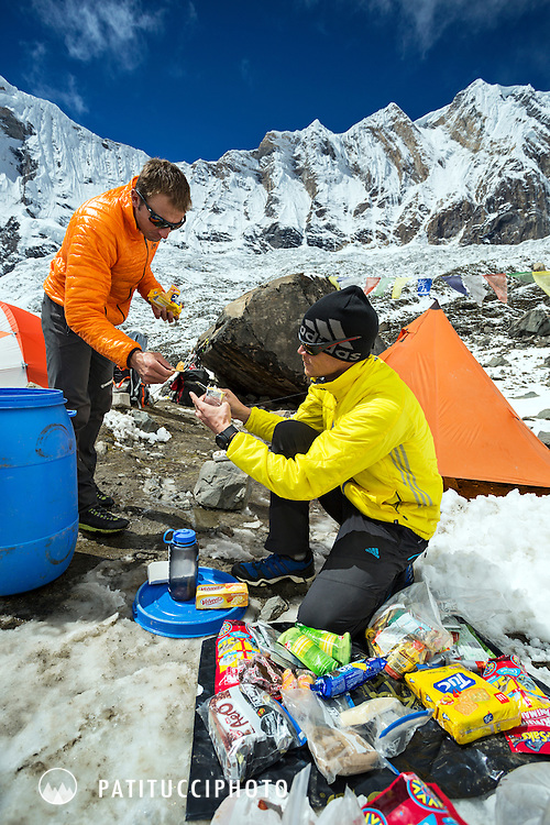 Ueli Steck returned to Nepal and the Annapurna south face in 2013 which he climbed solo, without oxygen, in one 28 hour alpine push, via a new route. The trip was his third attempt to climb the 8000 meter peak. Ueli and Don Bowie packing food and gear for Ueli's climb.