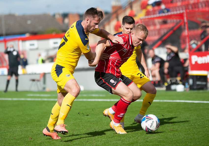 Lincoln City's Anthony Scully battles with Oxford United's James Henry, left, and Liam Kelly<br /> <br /> Photographer Andrew Vaughan/CameraSport<br /> <br /> The EFL Sky Bet League One - Saturday 12th September  2020 - Lincoln City v Oxford United - LNER Stadium - Lincoln<br /> <br /> World Copyright © 2020 CameraSport. All rights reserved. 43 Linden Ave. Countesthorpe. Leicester. England. LE8 5PG - Tel: +44 (0) 116 277 4147 - admin@camerasport.com - www.camerasport.com - Lincoln City v Oxford United