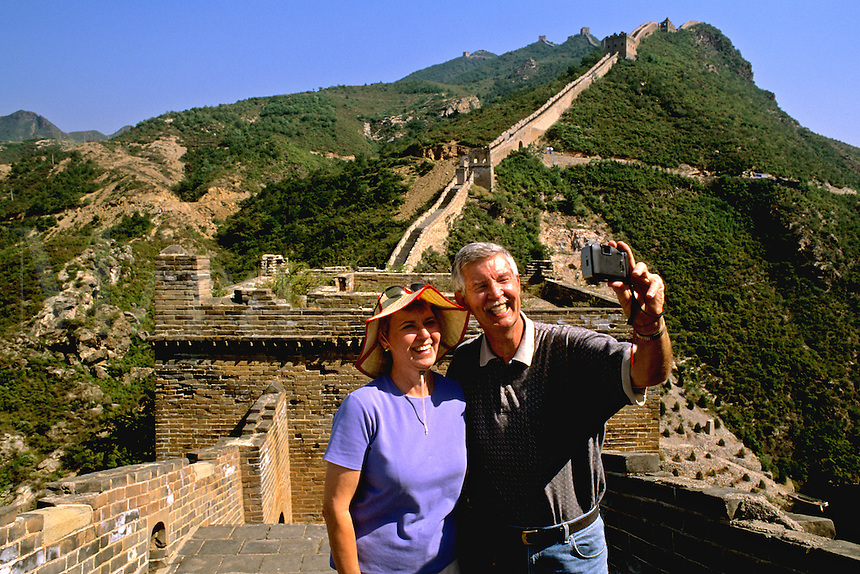 Healthy retired couple on the great Wall of China in Simatai