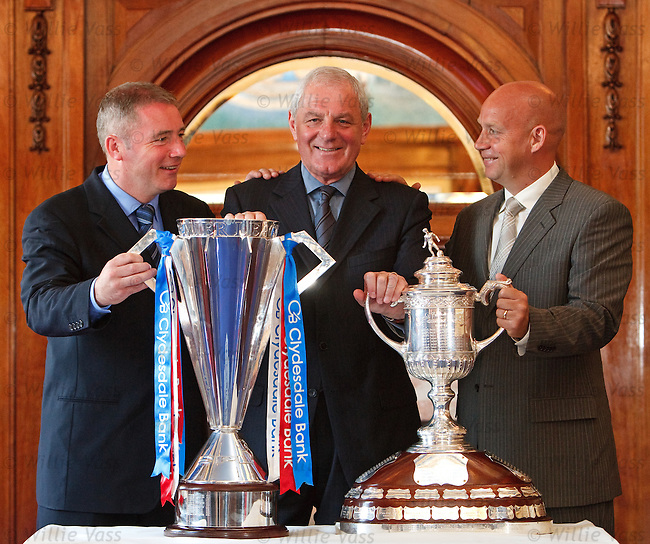 Walter Smith in the blue room at Ibrox flanked by Ally McCoist and Kenny McDowall with the SPL and Scottish Cup trophies after a double winning season for Rangers