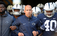 STATE COLLEGE, PA - SEPTEMBER 30:  Penn State head coach James Franklin leads the team out the tunnel and onto the field before the game with arms locked with injured DE Torrence Brown (left), and LB Jason Cabinda (40). The Penn State Nittany Lions defeated the Indiana Hoosiers 45-14 on September 2, 2017 at Beaver Stadium in State College, PA. (Photo by Randy Litzinger/Icon Sportswire)