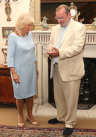 12 July 2016 - London, England - Camilla, Duchess of Cornwall, with Professor David Marsh as she presents the Professor with the Duchess of Cornwall Award for Outstanding Contribution to the field of Osteoporosis as she hosts the 30th Anniversary Garden Party for the National Osteoporosis Society in St James Palace in London. Due to inclement weather the event was moved indoors. The Duchess of Cornwall has been connected with the charity for nearly 30 years. Photo Credit: ALPR/AdMedia