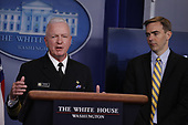 Admiral Brett Giroir, United States Assistant Secretary for Health, left, speaks during a news conference at the White House in Washington D.C., U.S. on Monday, April 20, 2020. <br /> Credit: Tasos Katopodis / Pool via CNP