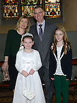 Natasha Stevenson who received her first holy communion in St Mary's church pictured with parents Mick and Miriam and sister Georgina. Photo:Colin Bell/pressphotos.ie