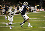 Nevada's Hasaan Henderson tries to make a reception against UC Davis defender Nate Walker during the second half of an NCAA college football game in Reno, Nev. on Thursday, Sept. 3, 2015. Henderson was shaken up on the play and came out of the game. Nevada won 31-17. (AP Photo/Cathleen Allison)