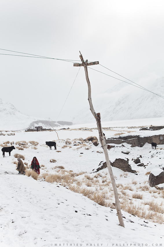 Electric poles in Sarhad village..Trekking back down from the Little Pamir, with yak caravan, over the frozen Wakhan river.