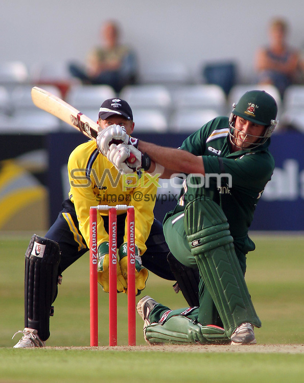 PICTURE BY VAUGHN RIDLEY/SWPIX.COM -  Cricket - Twenty20 Cup - Yorkshire v Nottinghamshire - Headingley, Leeds, England - 05/07/06...? Simon Wilkinson - 07811 267706...Yorkshire's Gerard Brophy (L) looks on as Nottinghamshire's Stephen Fleming (R) hits another boundary.