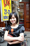 VIETNAM, Hanoi, portrait of a young woman Thuy in front of Cha Ca Thang Long restaurant