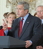 United States President George W. Bush calls on Congress to pass an Iraq War spending bill with no timetable for withdrawal in the East Room of the White House in Washington, D.C. on April 16, 2007.  Behind Bush are veterans and family members of service personnel.  <br /> Credit: Roger L. Wollenberg / Pool via CNP