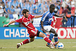Aug 22 2007:  Gonzalo Segares (left) of the Fire attempts to strip the ball from Eddie Johnson (7) of the Wizards.  The MLS Kansas City Wizards defeated the visiting Chicago Fire 3-2 at Arrowhead Stadium in Kansas City, Missouri, in a regular season league soccer match.