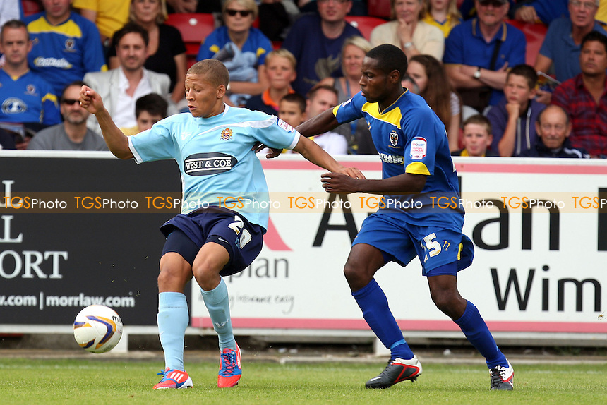 Dale Bennett of AFC Wimbledon and Dwight Gayle of Dagenham -  AFC Wimbledon vs Dagenham and Redbridge at the Cherry Red Records Stadium  - 01/09/12 - MANDATORY CREDIT: Dave Simpson/TGSPHOTO - Self billing applies where appropriate - 0845 094 6026 - contact@tgsphoto.co.uk - NO UNPAID USE.